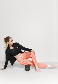 Puma - AMPLIFIED PANTS - Tracksuit bottoms - apricot blush - 1