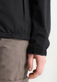 Vaude - WOMANS ESCAPE LIGHT JACKET - Waterproof jacket - black - 4
