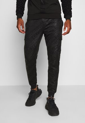 LINDEN - Tracksuit bottoms - black