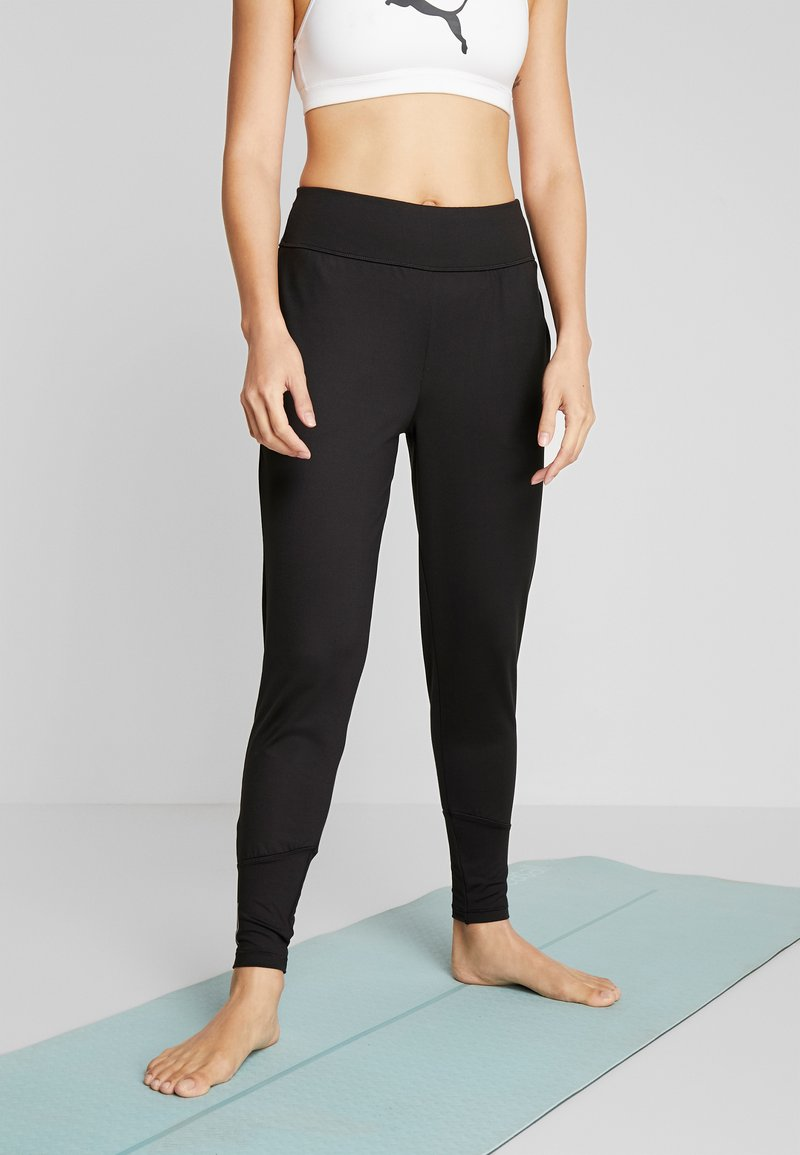 Puma - STUDIO TAPERED PANT - Pantalones deportivos - puma black