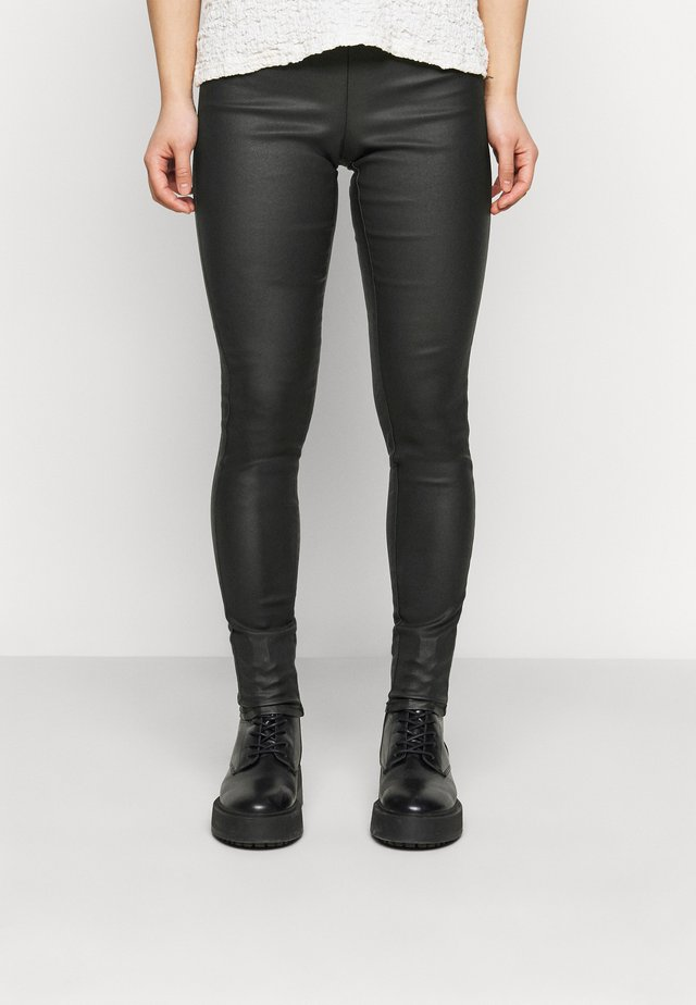 PCSKIN PARO COATED - Leggingsit - black