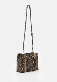 ALDO - SNAKE - Handbag - brown - 1