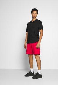 Jordan - JUMPMAN AIR  - Tracksuit bottoms - gym red/black - 1