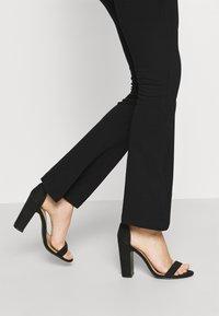 Even&Odd - FLARED LEG LEGGINGS - Leggings - Trousers - black - 3