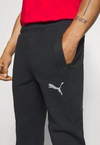 Puma - EVOSTRIPE - Pantalon de survêtement - black - 4