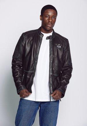 MIT ABSTEPPUNGEN - Leather jacket - black