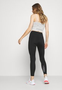 Puma - NU-TILITY HIGH WAIST 7/8 LEGGINGS - Leggings - black - 2