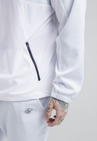 SIKSILK - TRANQUIL DUAL CUFF PANTS - Verryttelyhousut - light blue/white - 4
