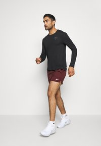 Nike Performance - RUN DIVISION FLEX STRIDE - Sports shorts - mystic dates/black/silver - 1