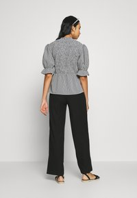 ONLY - ONLNELLA PANT - Trousers - black - 2