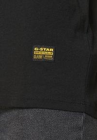 G-Star - GSRAW GYRE KNOT R T WMN CAP SL - Triko spotiskem - black - 3