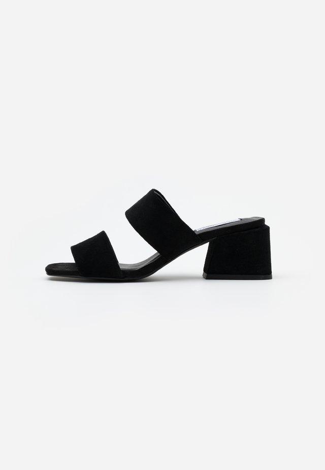 KELINE - Heeled mules - black