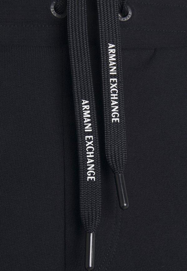 Armani Exchange Spodnie treningowe - navy/granatowy Odzież Męska UWKH