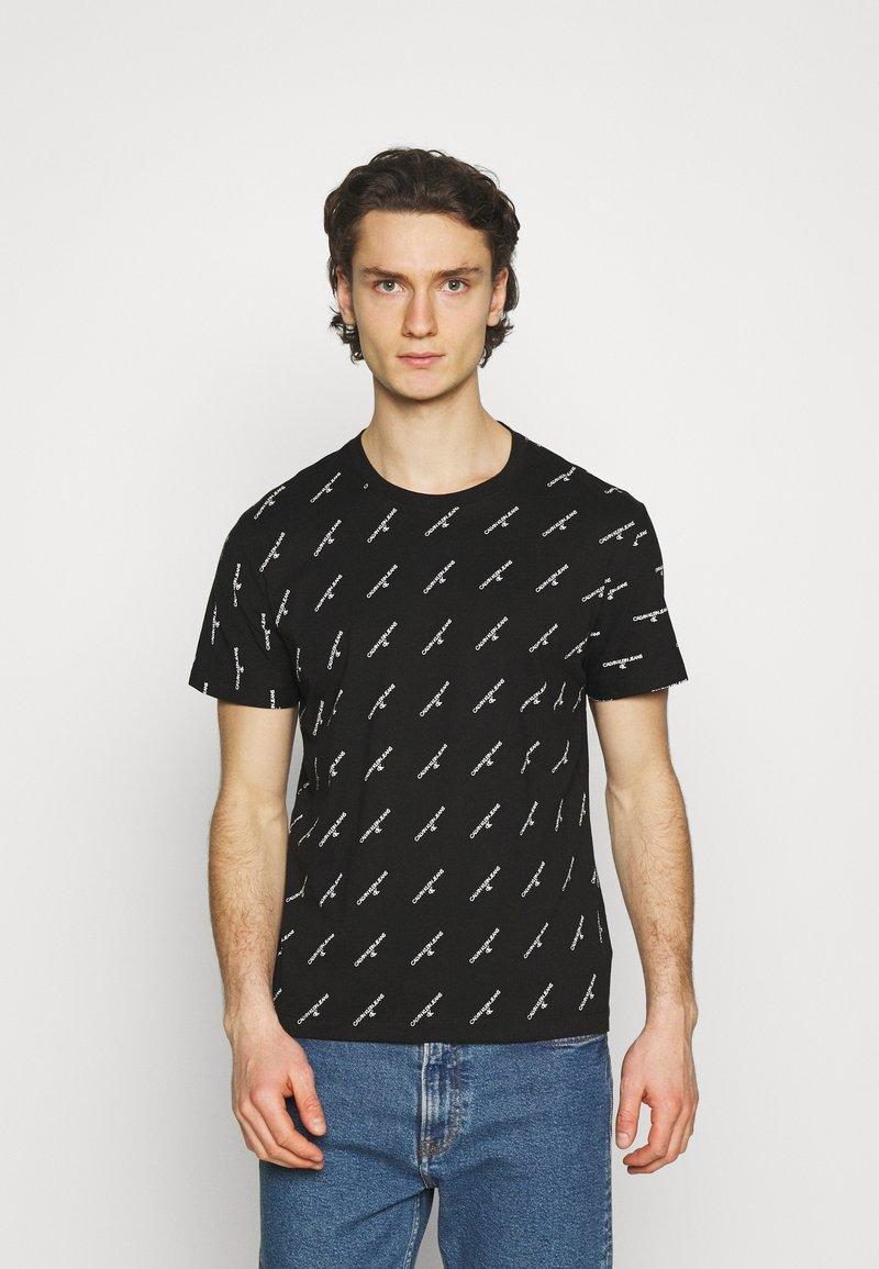 Calvin Klein Jeans - LOGO UNISEX - Print T-shirt - black