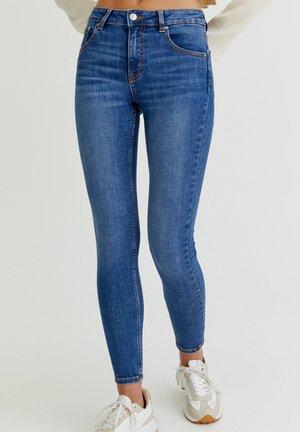 LOW WAIST - Jeans Skinny Fit - mottled blue