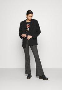 Vero Moda - VMKAMMA FLARED ABBY PANT - Trousers - dark grey melange - 1