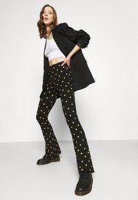 Colourful Rebel - DOTS BASIC FLARE PANTS WOMEN - Leggings - black - 3