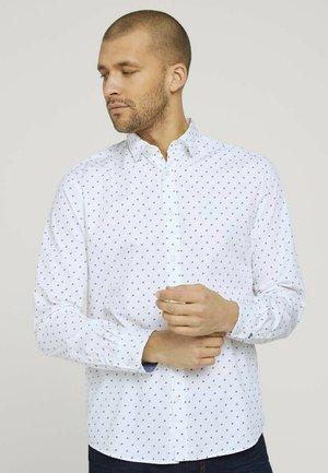 Shirt - white base blue element design