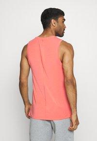 Nike Performance - DRY TANK YOGA - Sports shirt - magic ember/black - 2