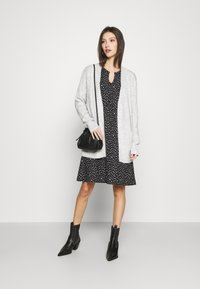 ONLY - ONLZILLE FRILLNECK DRESS  - Kjole - black/white ditsy - 1