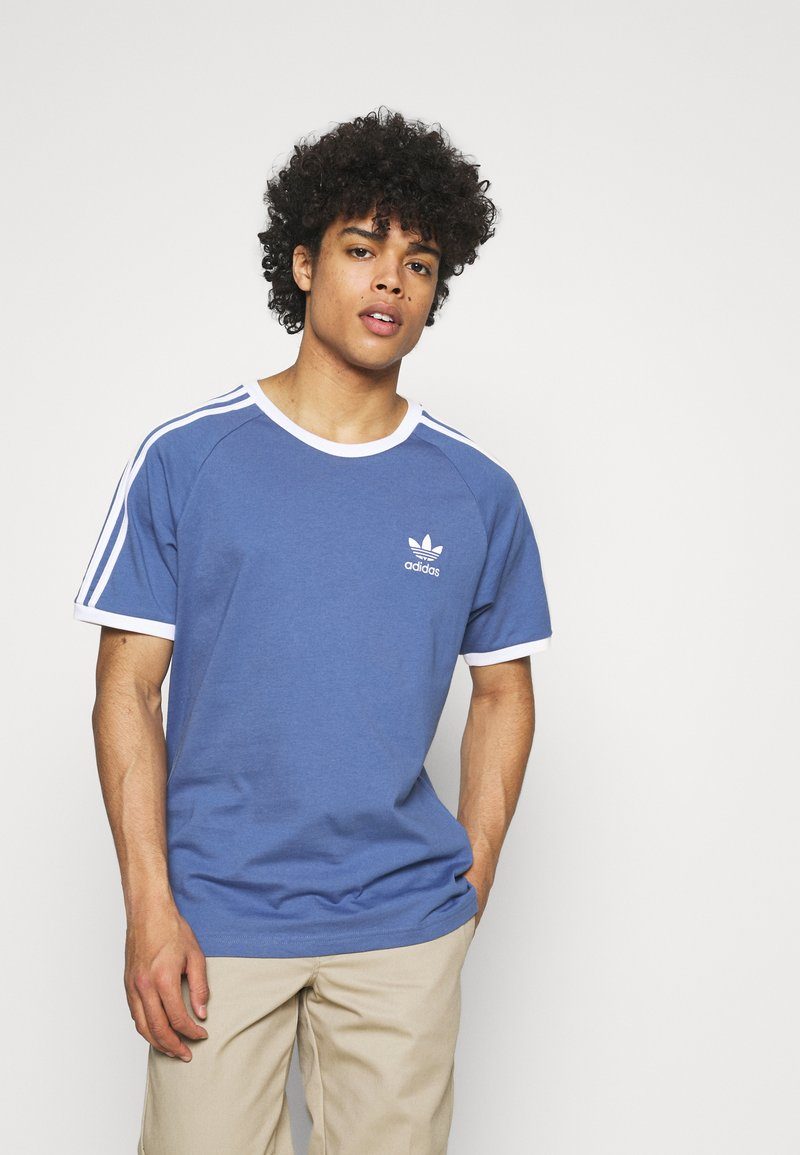 adidas Originals - STRIPES TEE - T-shirt med print - crew blue