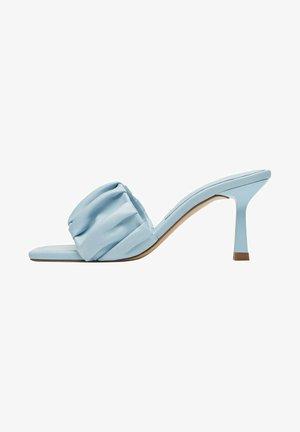 Heeled mules - light blue