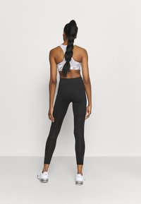 Puma - RUN FAVORITE RISE FULL - Tights - puma black