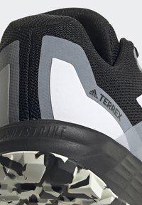 adidas Performance - TERREX TWO FLOW - Stabilty running shoes - savannah/core black/hi-res yellow - 6