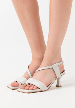 ASYMETHRIC STRAPS - Sandals - white