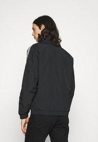 adidas Originals - LOCK UNISEX - Tunn jacka - black - 2