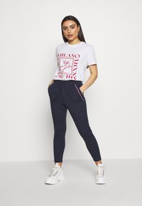 ONLY Petite - ONLPOPTRASH EASY NEW SPORTY TAPE PETIT - Trousers - night sky - 1