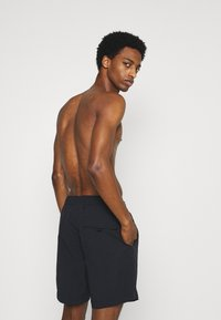 Champion - Swimming shorts - black - 1