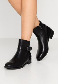 Caprice - Classic ankle boots - black - 0
