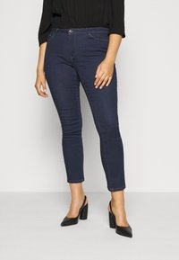 Vero Moda Curve - VMMANYA - Slim fit jeans - dark blue denim rinse - 0