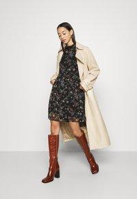 Vero Moda - VMTILI HIGH NECK SHORT DRESS - Day dress - black/tiny - 1
