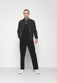 HUGO - DOLMAR - Polo shirt - black - 1