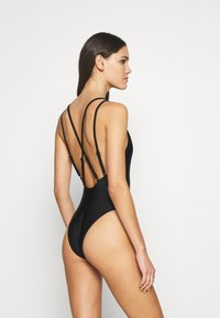 Hunkemöller - ANIMAL BATHING SUIT - Badedrakt - black - 2