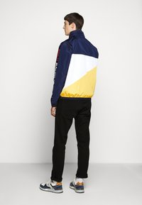 Polo Ralph Lauren - PACE FULL ZIP JACKET - Summer jacket - newport navy/yellow