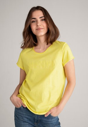 TARIA - Print T-shirt - hellgelb