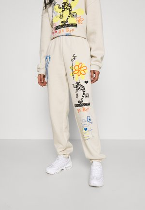 BALANCED LIFE JOGGER - Tracksuit bottoms - cream
