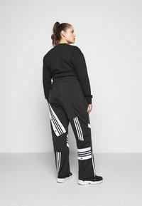 adidas Originals - CATHARI - Tracksuit bottoms - black - 2
