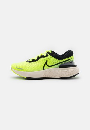 ZOOMX INVINCIBLE RUN - Neutral running shoes - volt/black/barely volt