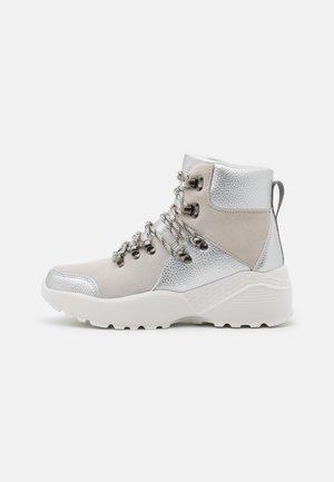 FARAH - Platform ankle boots - silver