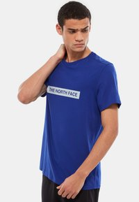 The North Face - M S/S LIGHT TEE - T-shirt med print - blue - 0