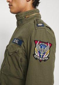 Polo Ralph Lauren - HERRINGBONE FIELD JACKET - Summer jacket - soldier olive - 6