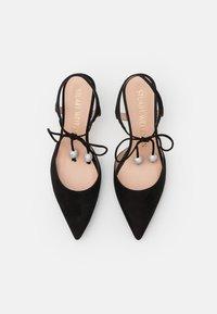 Stuart Weitzman - ORION  - Lace-up heels - black - 4