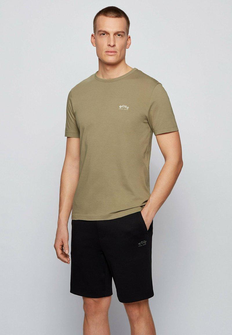 BOSS - TEE CURVED - Basic T-shirt - dark green