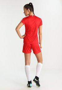 Craft - PROGRESS CONTRAST  - Triko spotiskem - bright red/white - 2