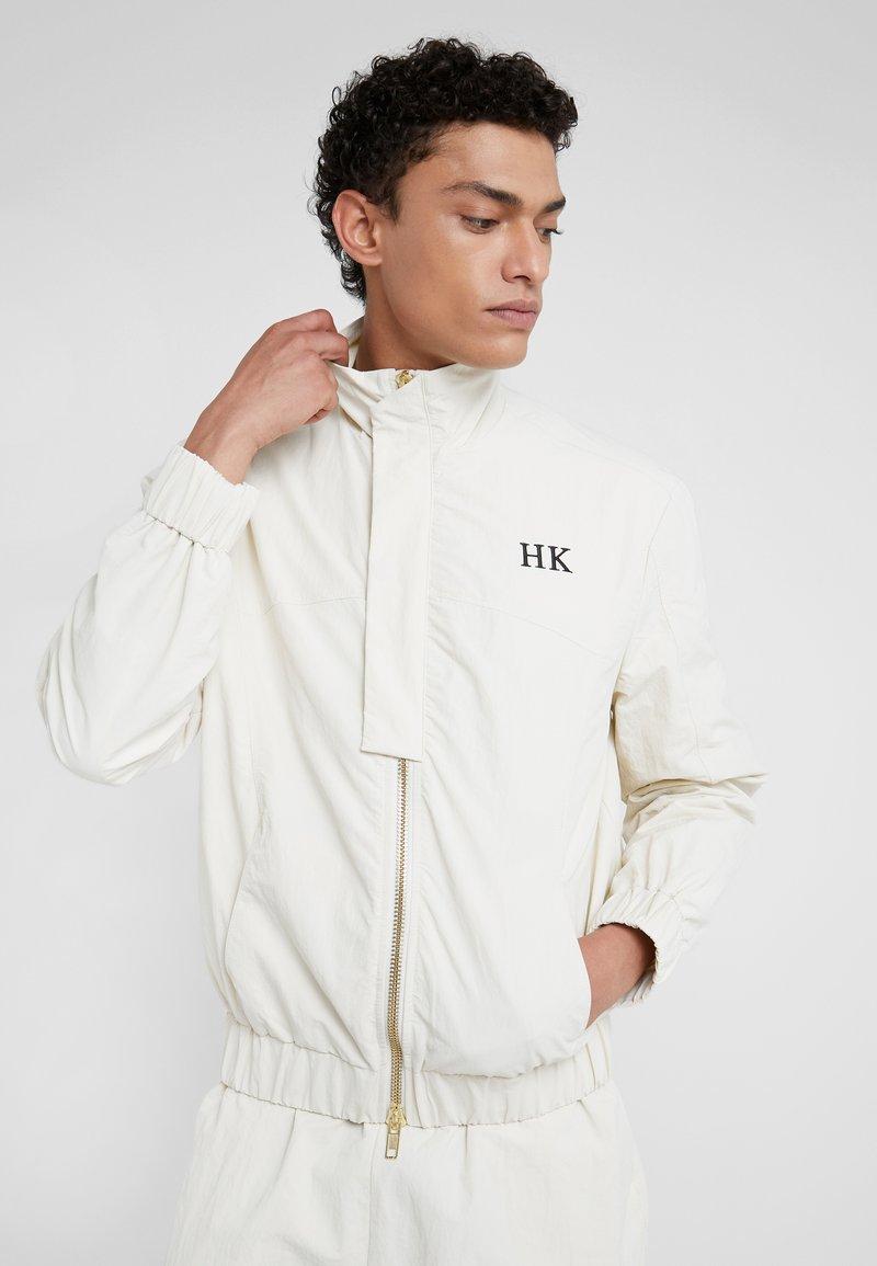Han Kjobenhavn - TRACK TOP - Giacca leggera - white