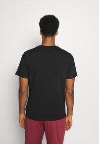 Tommy Hilfiger - LOGO TEE - Sports shirt - black - 2
